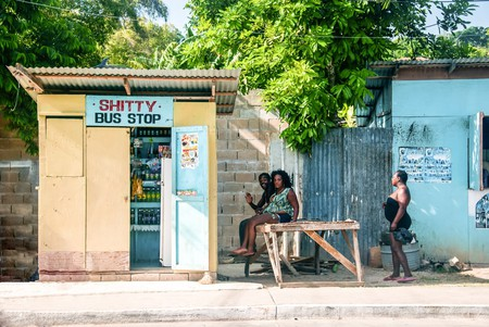 Jamaican people waiting for the bus