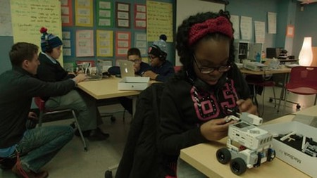 Middle-schoolers learn to program robots at a New York Public Library after-school innovation lab in Ex-Libris