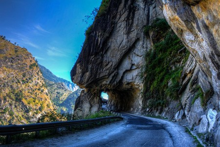 A winding and narrow mountain road in the Himalayas