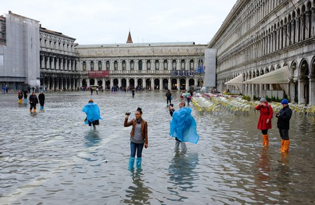 Tourists in Venice this November experience major flooding in St. Mark's Square