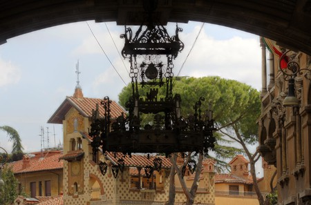 The wrought iron chandelier, with Villini delle Fate in the background