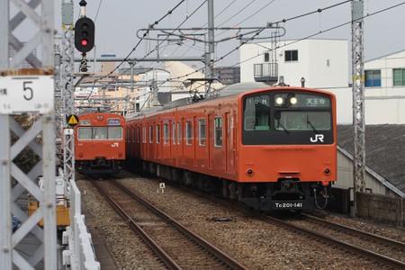 Two of the classic orange Loop Line train models.