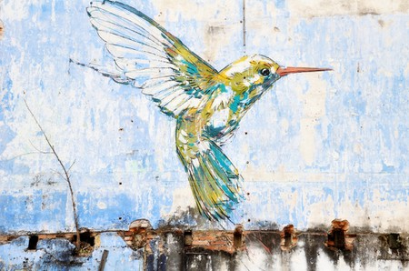 """""""Hummingbird"""" wall art painted by famous artist, Ernest Zacharevic in Ipoh, Malaysia"""