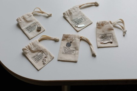 Feminist Charms Designed By Ruth Ewan And Joy BC For Glasgow Women's Library