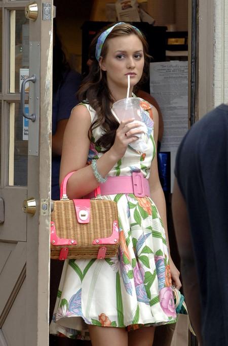 Leighton Meester clutches a Kate Spade bag