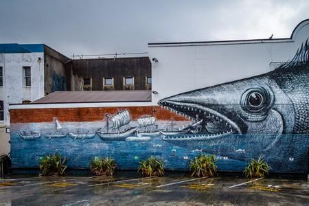 One of the murals by UK street artist Phlegm in Dunedin, New Zealand