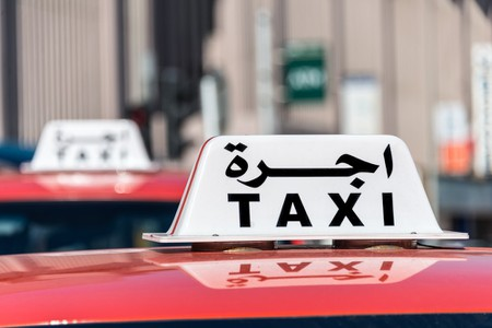 A taxi sign in Oman
