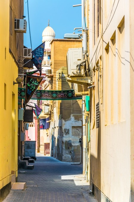 View of a narrow street on the Al Muharraq island in Bahrain
