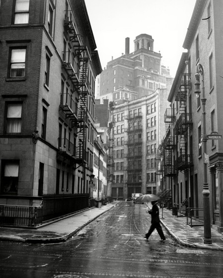 A man crosses the street at the corner of Gay Street and Waverly Place in Greenwich Village in New York City, 1945, NEW YORK, USA.