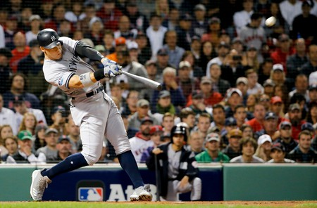 New York Yankees' Aaron Judge hits a home run against the Boston Red Sox during the first inning of Game 2 of a baseball American League Division Series, in Boston, USA - 06 Oct 2018