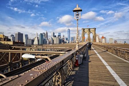 Brooklyn Bridge spans the East River between Brooklyn and downtown Manhattan