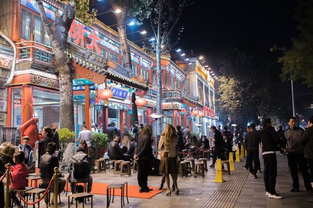 Beijing nightlife with colorful lights from a local restaurant.