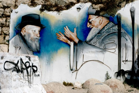 A wall painting in Hebron is showing an Jewish ultra-orthodox settler together with the prominent Chief Rabbi Yosef Ovadia
