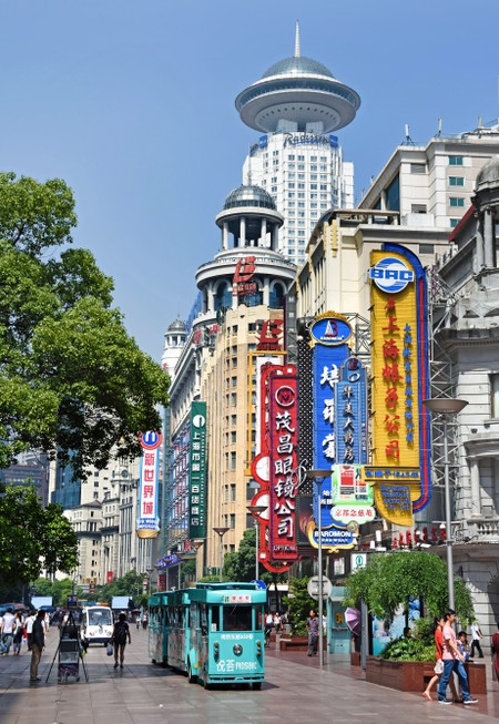 Visitors take a stroll on Nanjing Road, the main shopping street of Shanghai