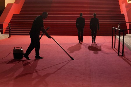 Red Carpet is cleaned at the end of the night at Cannes Film Festival