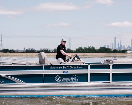Captain Bill Sheehan, Hackensack River Waterkeeper with New York City skyline in the background