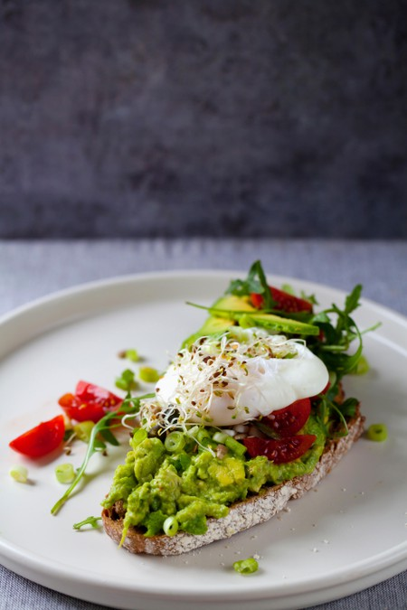 Rye toast with avocado, tomatoes and poached egg