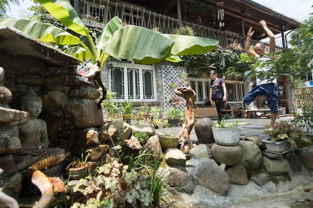People practice yoga at the Lilu Guest House on the Mogan Mountain (single use)