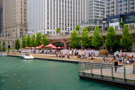 Chicago River with The River walk and surrounding downtown architecture in summer, Chicago, Illinois.. Image shot 2018. Exact date unknown.