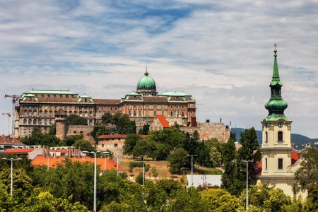 Buda Castle and bell tower of Taban Parish Church in Budapest, Hungary