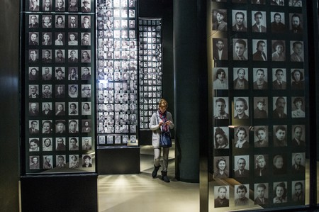 Visitors look at a mural with pictures of jewish victims at The World War 2 museum in the Polish city of Gdansk