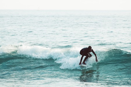 man doing surfboard on sea waves