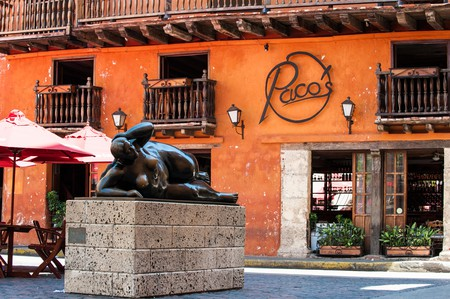 Statue of a fat woman reclining by Fernando Botero in the Plaza de Santo Domingo, Cartagena de Indias, Colombia