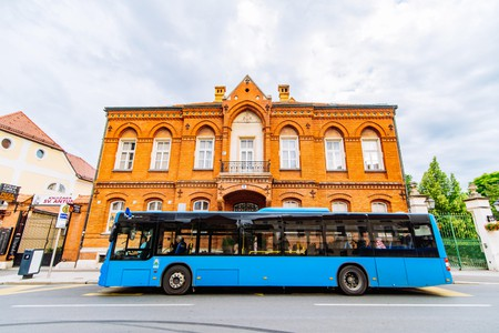 city bus station with blue bus