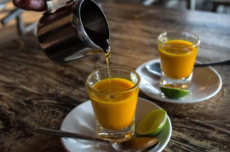 Adding honey to jamu shots