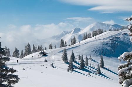 Snowcat tows skiers toward Highland Peak, Aspen Highlands Ski Area, Aspen, Colorado.