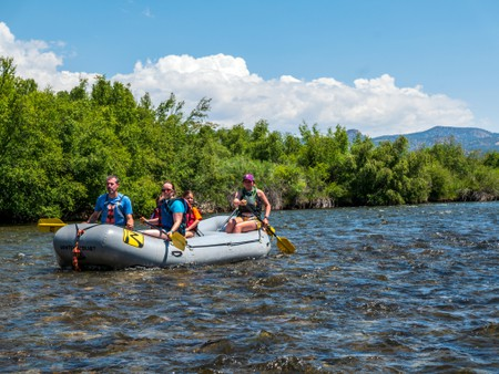 Rafting the Arkansas RIver, which runs runs through the downtown historic district of the small mountain town of Salida, Colorado, USA