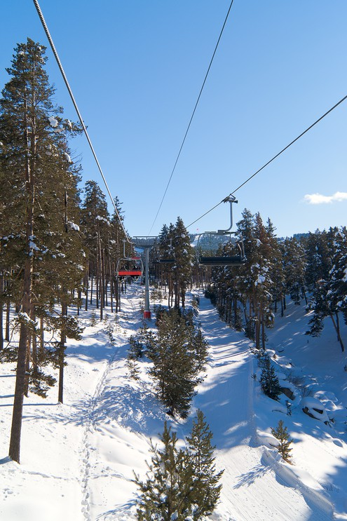 Chairlift in winter forest on asunny day in Sarikamis
