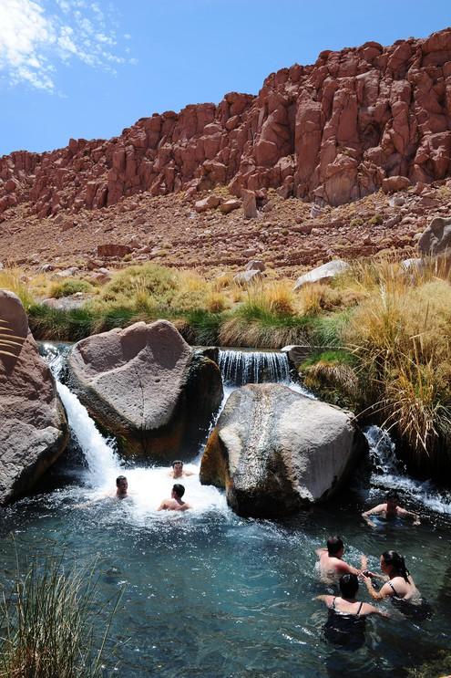 People bathing in the waters of the Termas de Puritama near San Pedro de Atacama.