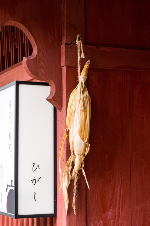 Traditional sign, dried sweetcorn hanging in doorway at merchant's house in Edo streets in Higashi Chaya.