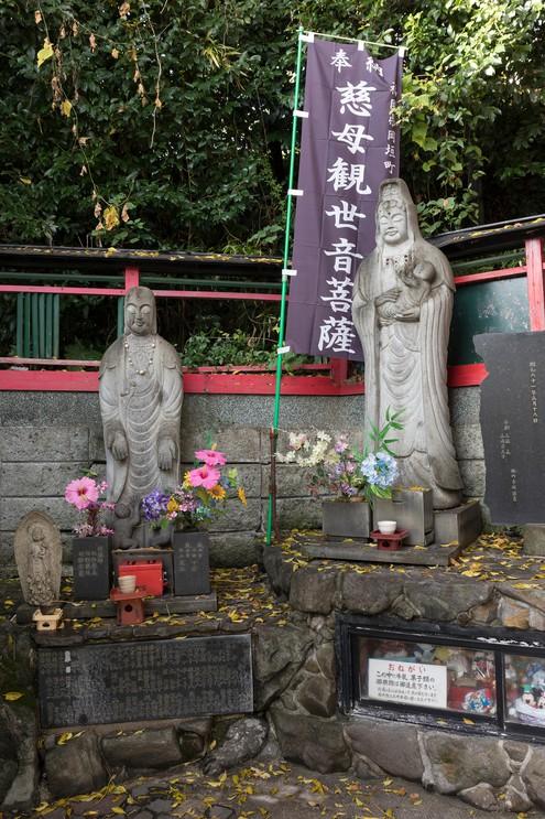 Old stone statue and shrine at the Kumamoto-jō shrine