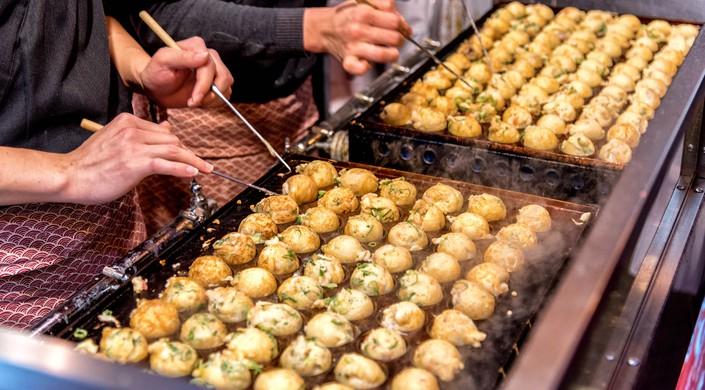 Cooking Takoyaki on hot pan in Osaka