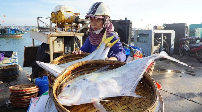 Locals prepare their catch for sale