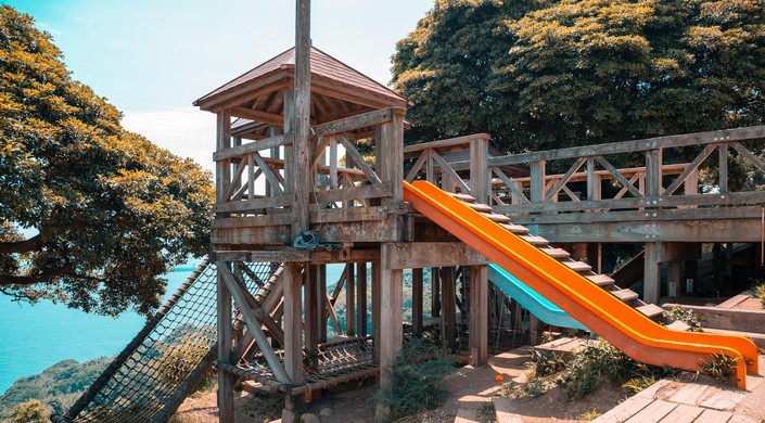 Wooden playground equipment with blue ocean in Nokonoshima, Fukuoka, Japan