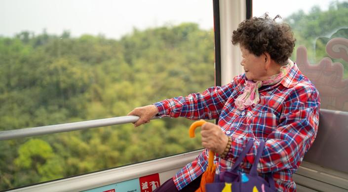 Lady enjoying a ride on the Maokong Gondola