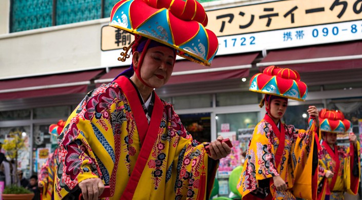 Okinawan residents perform cultural dances during the Nago City 50th Annual Cherry Blossom Festival at Nago Central Park