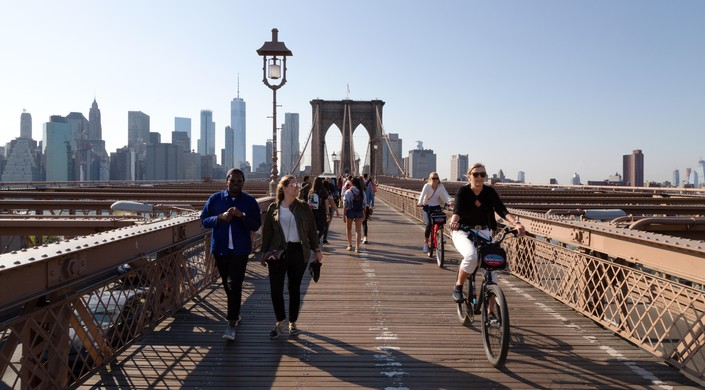 People walking and cycling the Brooklyn Bridge, Brooklyn, New York city USA