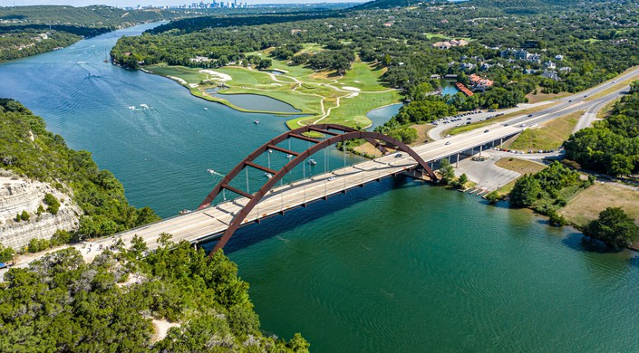 Gorgeous view of the Pennypacker bridge over the Colorado River. You can see the Austin Country Club and downtown Austin, TX in the background.