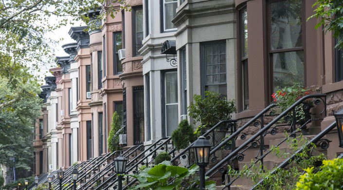 Classic Brownstone architecture lines the residential streets of much of the Park Slope neighborhood in Brooklyn, NY.