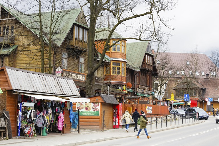 Wooden building until 1898 the biggest hotel in Zakopane. Nowadays it houses famous Gazdowo-Kuznia restaurant and milk-bar ©Marekusz / Shutterstock