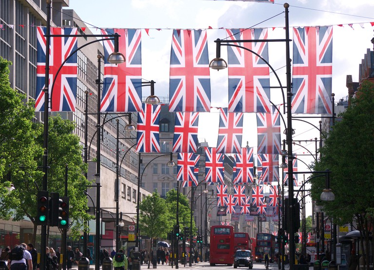 View looking along lines of many union jack flags hanging above Oxford Street in London for the Queen's Diamond Jubilee 2012