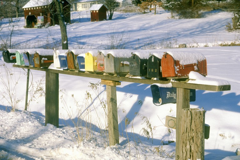 Row of residential mailboxes at winter in rural Woodstock, NY