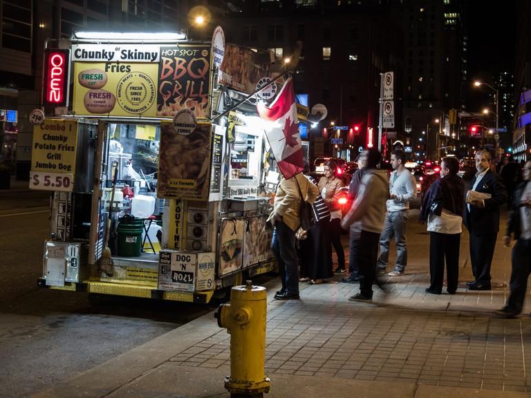 Food truck along Front Street in downtown Toronto, Canada. © Atomazul / Shutterstock