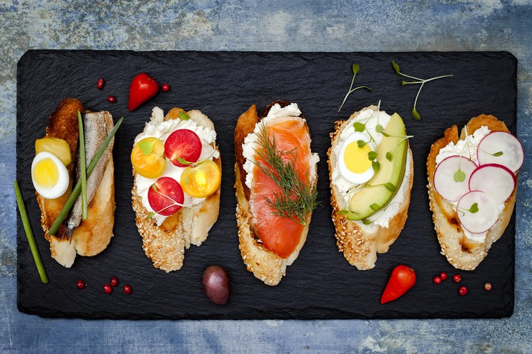 Brushetta or authentic traditional spanish tapas for lunch table. Delicious snack, appetizer, antipasti on party or picnic time | ©zarzamora/Shutterstock