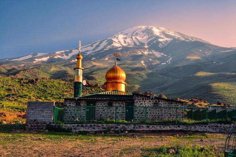 Picturesque mosque underneath volcano Damavand, highest peak in Iran | ©Michal Knitl/Shutterstock