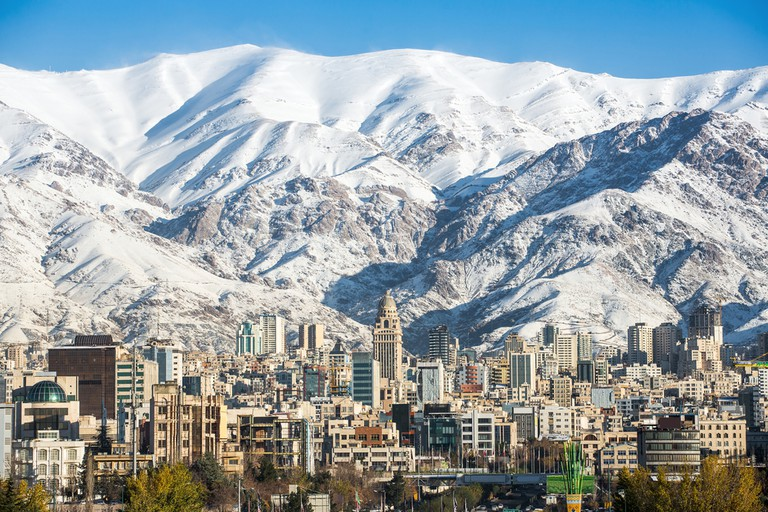 Winter Tehran view with a snow covered Alborz Mountains